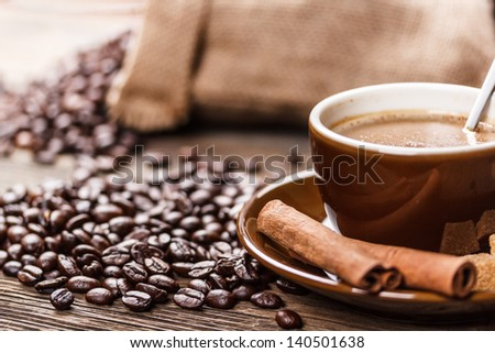 Coffee cup with roasted beans - stock photo
