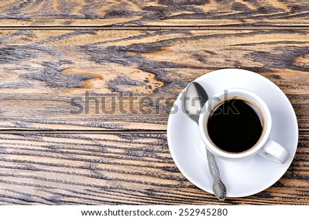 Coffee cup with spoon and saucer on the table - stock photo