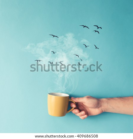 Coffee cup with steam, clouds and birds. Coffee concept. Flat lay.