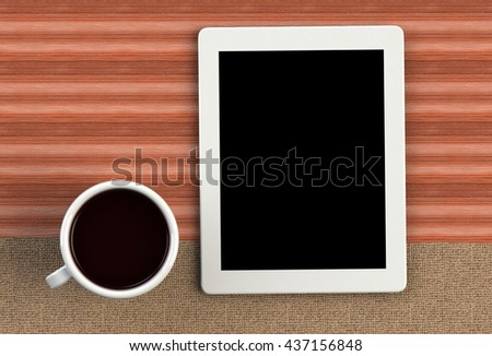 Coffee cup with tablet on brown fabric and wood table, 3D rendering