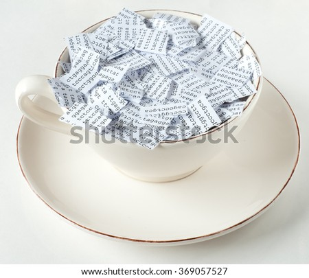 Coffee cup with torn DNA sequence in it