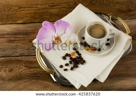Coffee cup with white and pink orchids. Coffee break. Morning coffee. Cup of coffee. Coffee cup. Strong coffee. Coffee mug. Coffee - stock photo