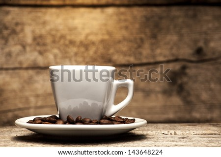 Coffee cup with wooden background - stock photo