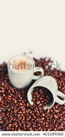 Coffee cups and coffee beans. Vintage filter. - stock photo