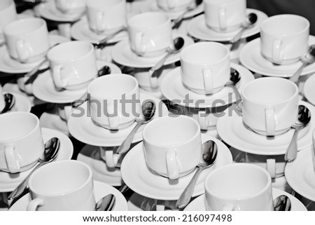 coffee cups, plate and spoon composition in a restaurant. - stock photo