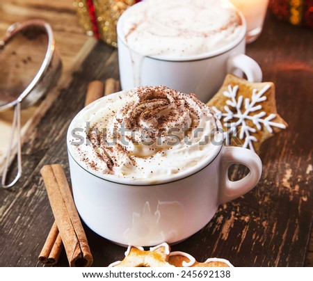 Coffee Cups with Whipped Cream, Cocoa Powder and Cinnamon - stock photo
