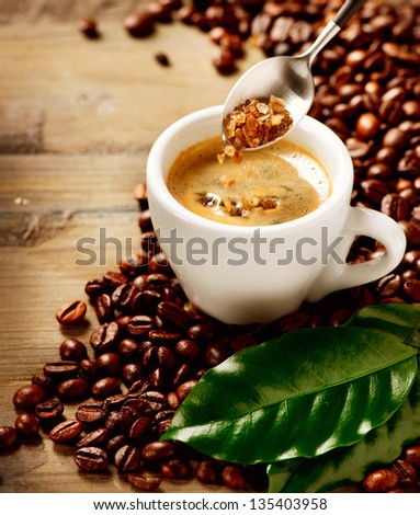 Coffee Espresso. Cup Of Coffee and Brown Sugar - stock photo