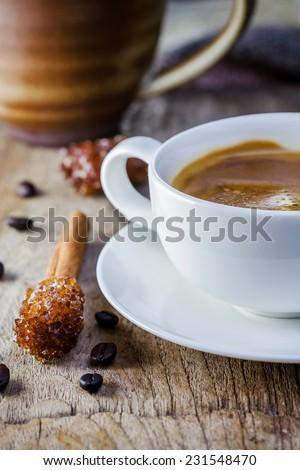 Coffee Espresso. Cup Of Coffee and sugar stick cinnamon - stock photo