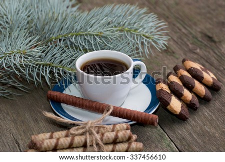 coffee, fir-tree branch and two groups of beautiful cookies, subject holidays Christmas and New Year - stock photo