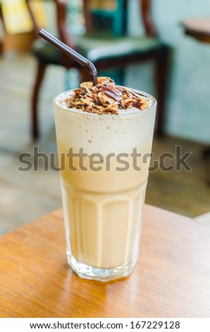 Coffee frappe with almond on top in coffee shop