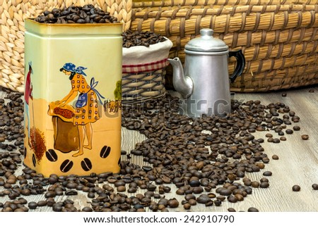Coffee, fresh aromatic coffee beans in an old metal box with the Brazilian workers in the act of gathering coffee, composition with baskets and coffee - stock photo