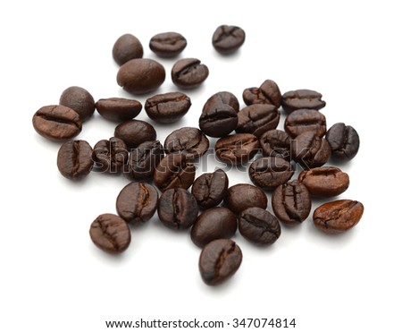 coffee grains and leaves on white background