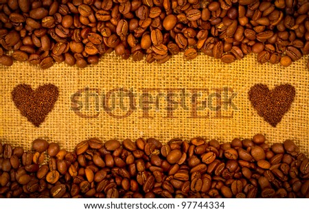 Coffee grains on the burlap background with copy space