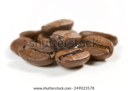 coffee grains on white background - stock photo