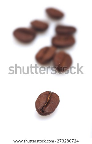 Coffee grains on white background