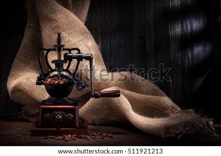 Coffee grinder and beans coffee in the rustic style with burlap