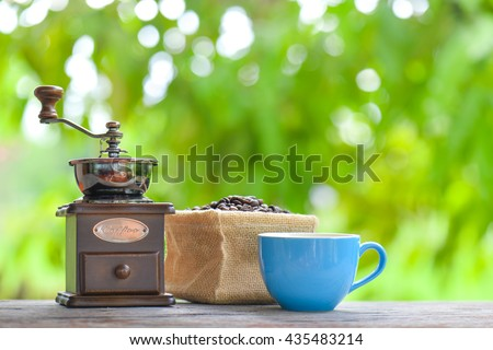 Coffee grinder and coffee cup  - stock photo