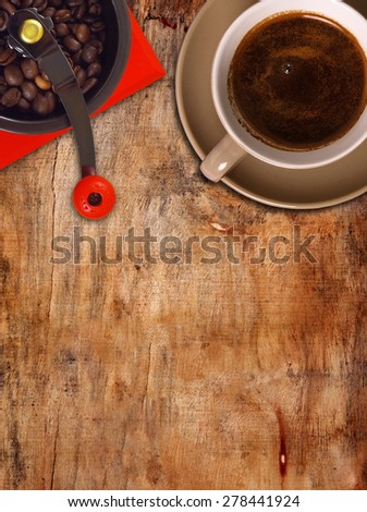 coffee grinder and cup on the table,top view