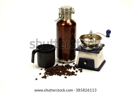 Coffee grinder and roasted coffee beans isolated on white background