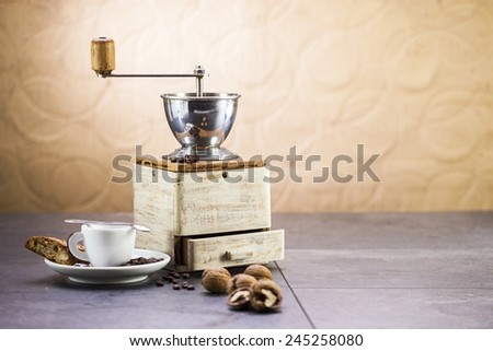 Coffee grinder, coffee and sweet Italian cookie cantuccini with nuts