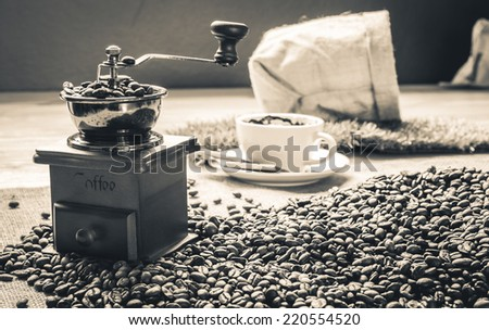 Coffee grinder cup sack and beens on vintage sepia style - stock photo