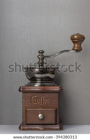 Coffee grinder hand with space to add text.