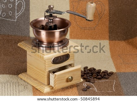 Coffee grinder on a kitchen towel