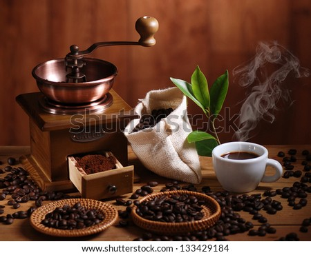 coffee grinder with coffee beans and cup of espresso - stock photo