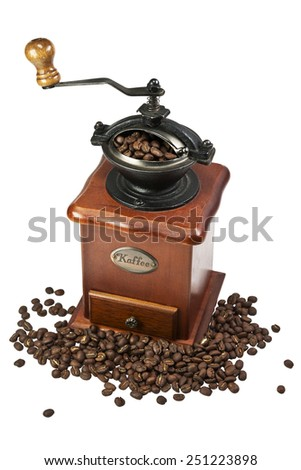 Coffee grinder with coffee beans, isolated on white background - stock photo