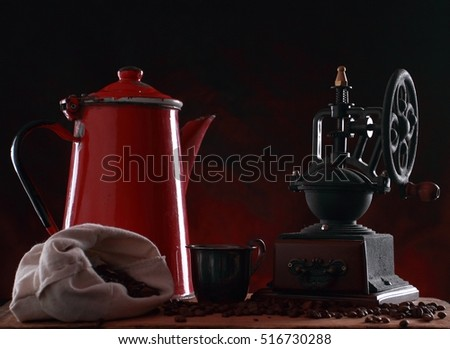 Coffee grinder with red metal jug for hot coffee. Studio shot