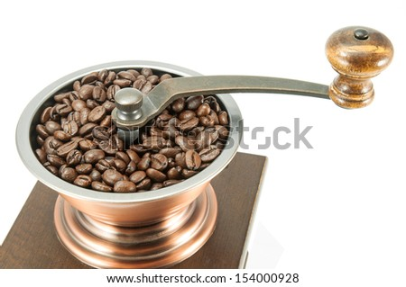 Coffee grinder with roasted coffee beans - stock photo