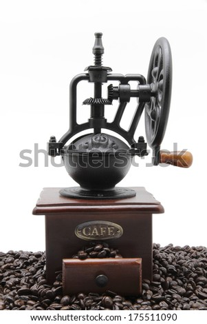 coffee grinder with some coffee beans