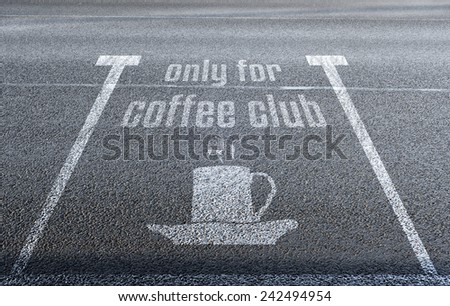 """coffee icon with text """"only for coffee club"""" on the parking lot - stock photo"""