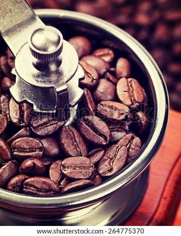 Coffee in a coffee grinder. Vintage retro hipster style version  - stock photo