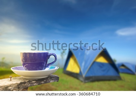Coffee in a cup on balcony with nature and mountain background - stock photo