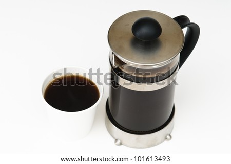 Coffee in a French press with take out paper cup on white
