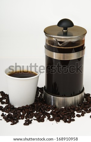 Coffee in a French press with take out paper cup on white and beans - stock photo