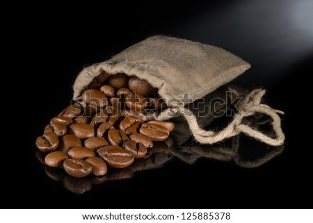 Coffee in a sack on a black background