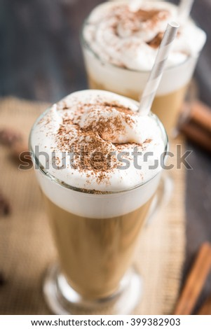 Coffee in glass on the wooden background. Shallow depth of field.