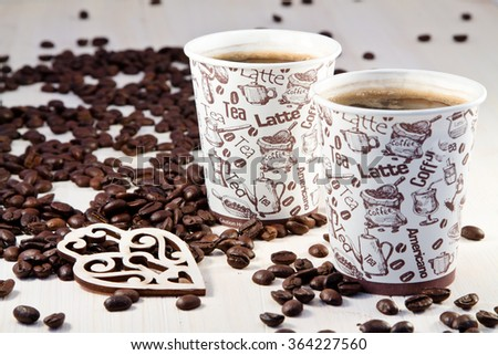 Coffee in paper cups and coffee beans  - stock photo