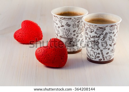 Coffee in paper cups and hearts - stock photo