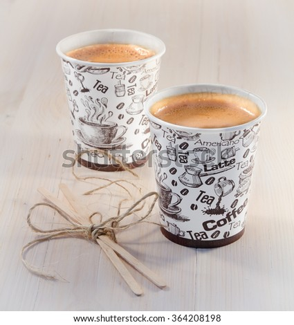 Coffee in paper cups and wooden sticks - stock photo