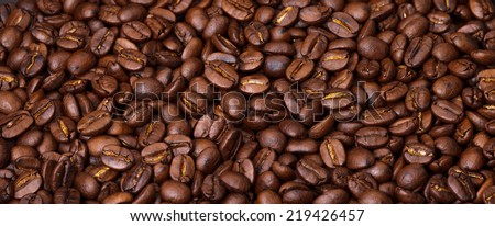 Coffee is a brewed beverage prepared from the roasted or baked seeds of several species of an evergreen shrub of the genus Coffea.