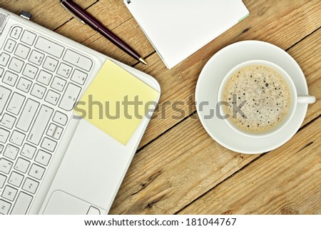 coffee, laptop and notes on wooden surface