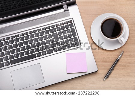 Coffee,laptop and post it work on office desk - stock photo