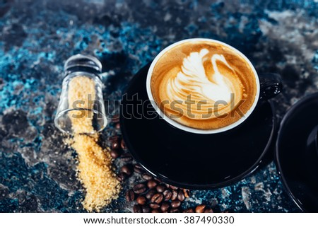 Coffee latte art, barista and bartender creating machiatto coffee - stock photo