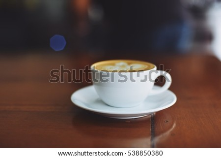coffee latte art in coffee shop vintage color tone