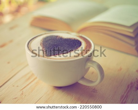 coffee latte heart in vintage color tone - stock photo