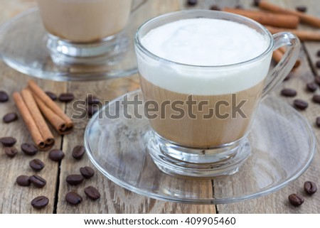 Coffee latte in glass cups on a wooden table - stock photo