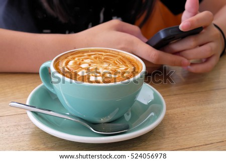 Coffee Latte on wood background.